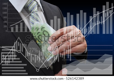 Businessman putting euro banknotes in suit pocket with virtual panel of pie chart and other chart , business concept