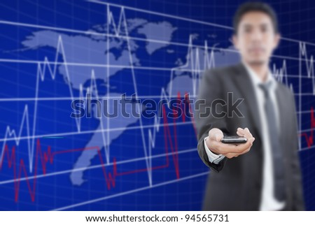 Businessman putting mobile phone for trade stock market.