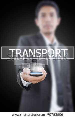 Businessman putting mobile with transport word. - stock photo