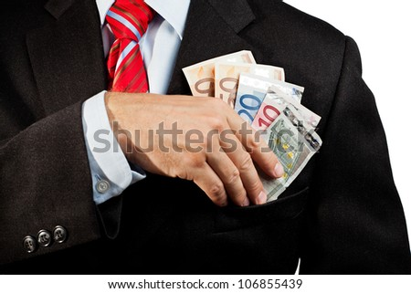 Businessman putting money in his pocket.