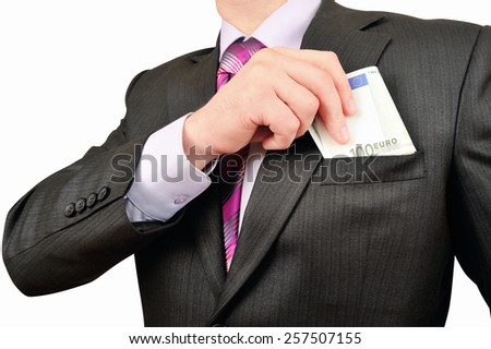Businessman putting money in your pocket - stock photo