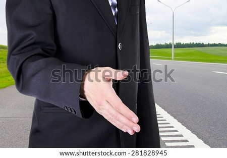 Businessman Putting Money in Your Pocket. Isolated on White Background - stock photo