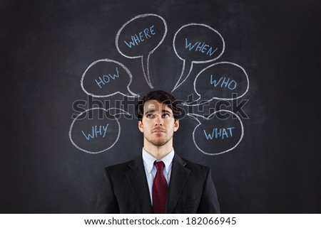 Businessman questions about life draw on the blackboard - stock photo