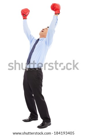 businessman raise arms up to win the competition - stock photo
