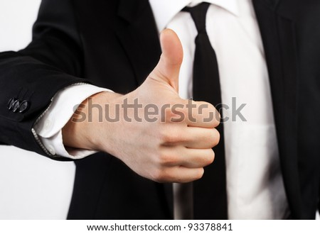 Businessman raised his thumb up, shows that all OK