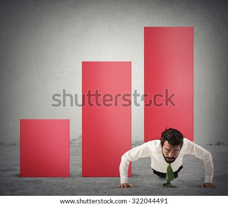 Businessman raises a statistic with a bending - stock photo