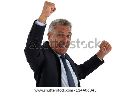 businessman raising his fists - stock photo