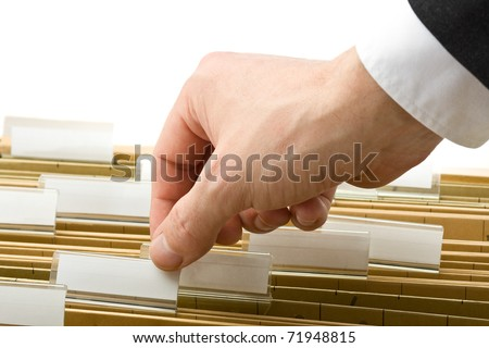 Businessman reaching for office folder in drawer - stock photo