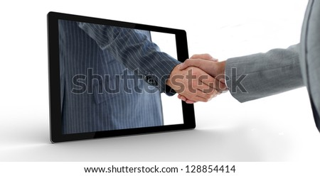 Businessman reaching out from tablet and shaking hands with other businessman