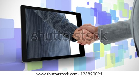 Businessman reaching out from tablet and shaking hands with other man on purple digital background