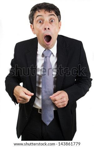 Businessman reacting in shocked horror or utter amazement standing with his mouth open, isolated on white - stock photo