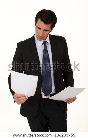 Businessman reading a document - stock photo