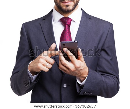 Businessman reading a message on his smartphone, isolated on white