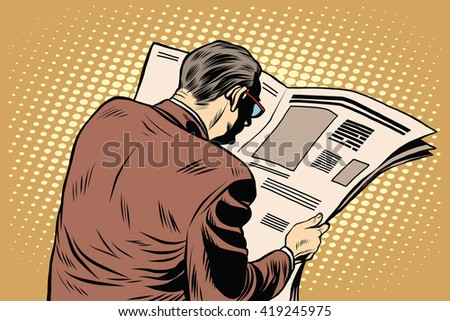 Businessman reading a newspaper - stock photo