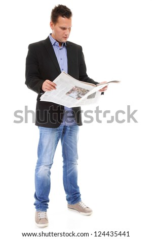 Businessman reading a newspaper full length isolated on white background - stock photo