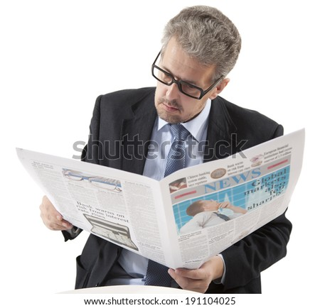 Businessman reading a newspaper on a white background - stock photo