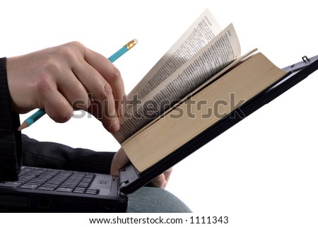 "Businessman reading an e-book on his laptop. Special way of showing how easy it is to read an ""electronic"" book. Book is a dictionary, so no copyright problems."