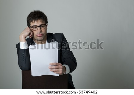 Businessman reading document - stock photo