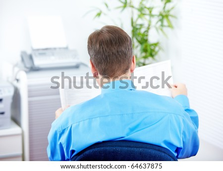 businessman reading newspaper in the office - stock photo
