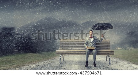 Businessman reading old book - stock photo