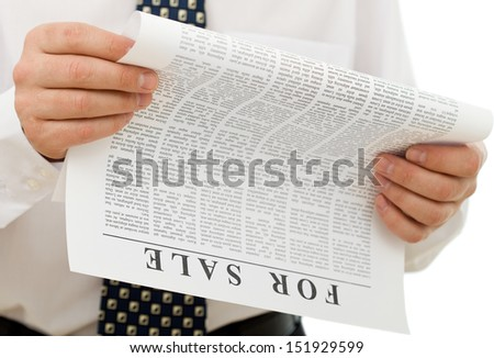 Businessman reading sales ads - closeup on hands and fake text paper - stock photo