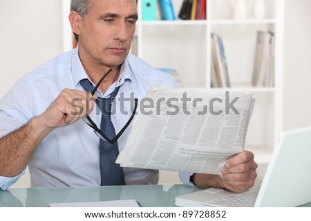 businessman reading the newspaper - stock photo