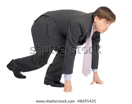 Businessman ready to compete isolated on a white background