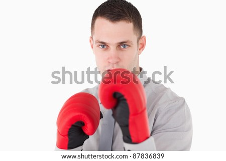 Businessman ready to fight against a white background