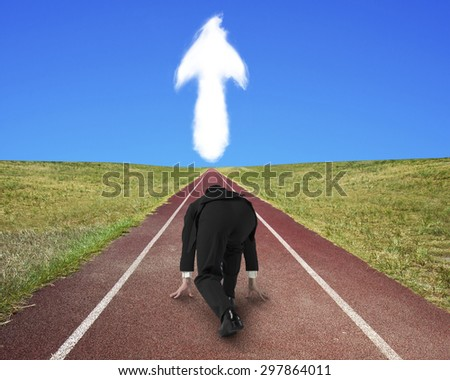 Businessman ready to race on running track toward arrow up shape cloud, with blue sky background. - stock photo