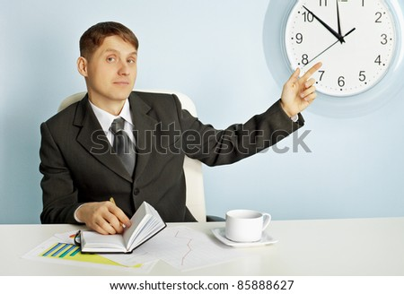 Businessman recalls saving time - stock photo