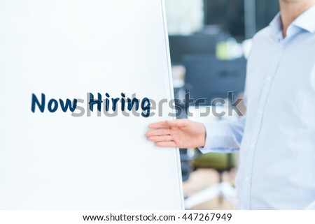 Businessman (recruiter, HR staffer) attract new employees on company presentation - human resources concept. - stock photo
