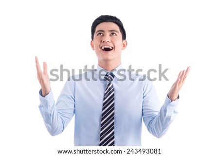 Businessman rejoicing for his success isolated over white background. Asian young entrepreneur with arms up celebrating his victory  - stock photo
