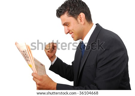 Businessman rejoicing with success while reading the newspaper - stock photo