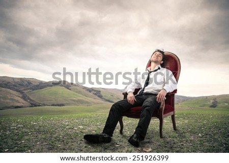 Businessman relaxing after work  - stock photo