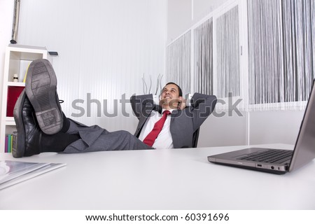 businessman relaxing at the office with his shoes on the desk (isolated on white) - stock photo