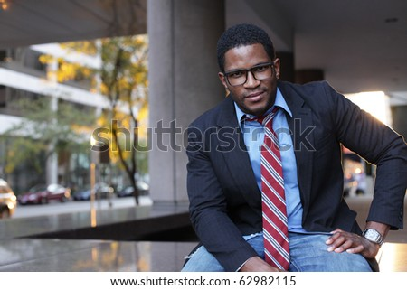 Businessman Relaxing in City with Jeans On - stock photo