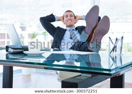 Businessman relaxing in his swivel chair in the office