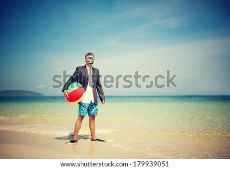 Businessman Relaxing On a Beach with Ball - stock photo
