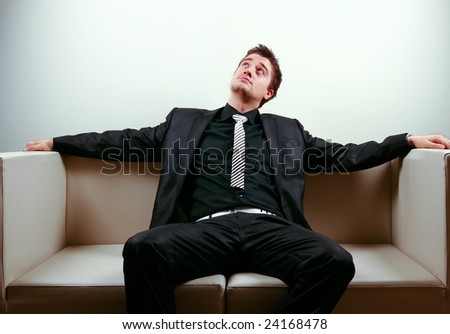 Businessman relaxing on lounge