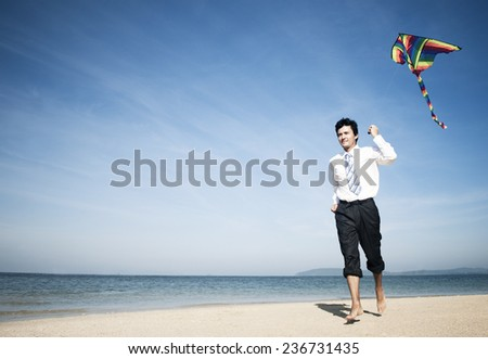 Businessman relaxing on the beach. - stock photo