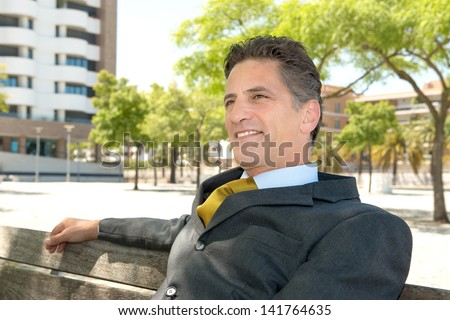 Businessman relaxing outdoor sin the park