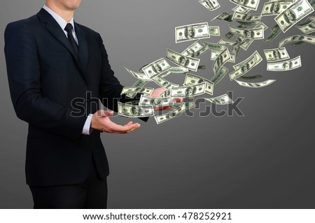businessman release floating 100 dollar bill