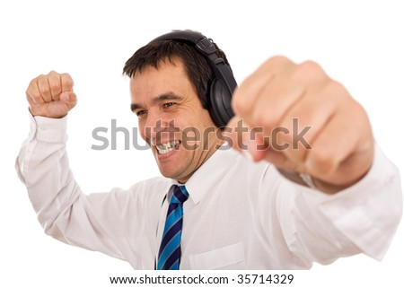Businessman releasing stress listening to music and gesturing - isolated - stock photo