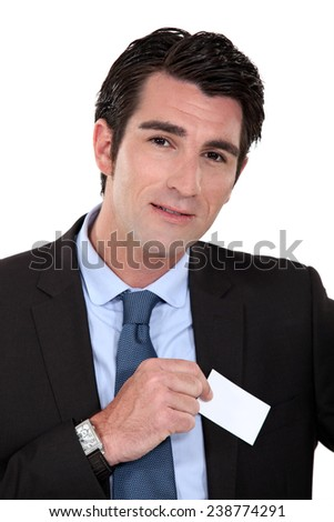 Businessman removing card from pocket - stock photo