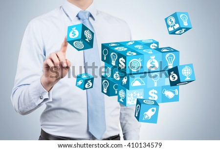 Businessman resolving cube puzzle on light background - stock photo