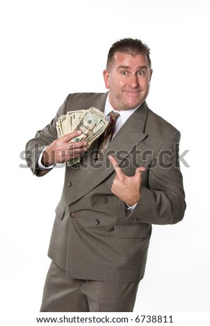 Businessman responds in joy after receiving cash for a job well done.