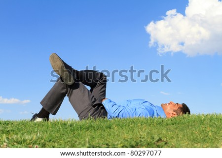 businessman resting at the park - stock photo