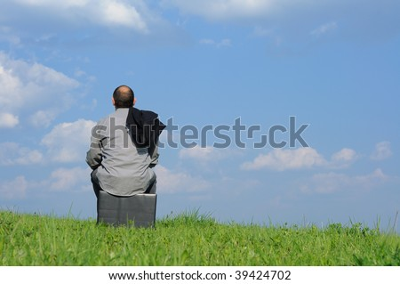 businessman resting on top and looking forward