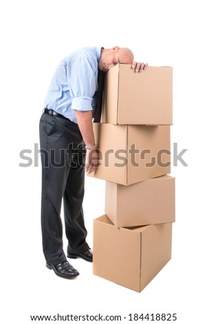 Businessman resting over a stack of cardboard boxes