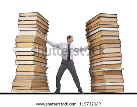 businessman restrains with both hands gripping it from two sides like a vise pile of books - the idea of education, knowledge of congestion, examinations and learning information